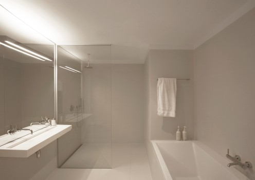 white-bathroom-design-glass-wall-shower